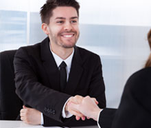 Smiling man shaking hands with someone